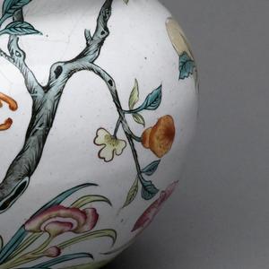 A copper vase with floral enamel decoration.