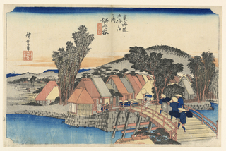 Scene of busy merchants quickly crossing the Shimmachi bridge into town. Two women are sitting enjoying a cup of tea at the base of the bridge.  A row of colorful rooftops continues into the distance and under the hilltop of a large mountain.