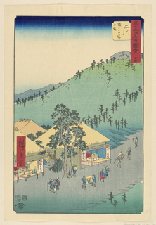 This scene shows a trail of people traveling up the road. At the base of the print is a rest stop where people can stop for tea or sustenance. Beyond the road is a lovely landscape scene which is typical in a Hiroshige print.