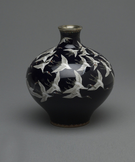 A black bulbous vase with a small neck. Vase depicts a flock of white birds flying around the top of the vase. Both top and bottom of the vase have the same, small, decorative band around it.