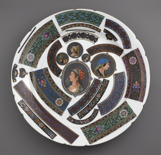 A sample pattern plate displays a variety of patterns in numerous colors. This white plate has samples on both the front and back of the plate, including five portraits on the front.