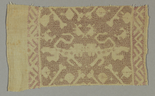Border fragment showing a pattern of heraldic lions and small birds. In red silk on linen.