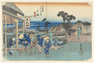 """Here is a spritely scene of travelers outside a teahouse of the town of Totsuka. From Edo (Tokyo) to Totsuka at the time, was about one day's journey. There is a man gingerly mounting off his horse. On the left of him, a female maidservant, finely dressed is greeting the visitors after their long voyage. There is a man on the right, standing next to the horse, is a porter, with his back facing us. Next to him is a woman who is carrying a large bundle, still balanced on her back. On the right side is an elderly man, nimbly balancing many bundles on his body while crossing the bridge.  A milestone next to the bridge says, """"For Kamakura, Turn Left."""" The animated indigo streaks on the foreground indicate that nightfall is swiftly approaching."""