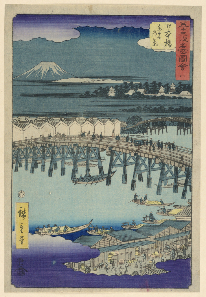 The bird's eye view overlooking rooftops in a district in Edo during the night. Mt. Fuji accompanies the light and dark silhouettes of the bridge and city.  Purple clouds frame the top and bottom of the print