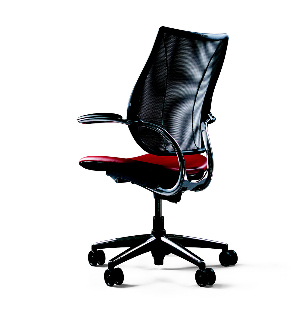 Contoured rectangular black plastic back with black mesh fabric, set into aluminum frame with two short arms above contoured rectangular textile-covered seat surmounting base composed of shaft on four splayed feet with black castors.