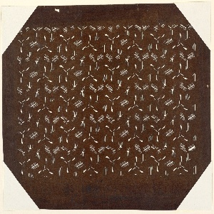 Abstract hexagons is formed using multiple wisps of lines craved out. There is a three pronged shape that is cut in an abstract manner. represent the pattern on a tortoise shell and signify longevity and good fortune. It is also used for Samurai armor designs.