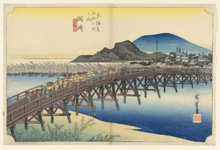 Daimyo procession crossing trestle-bridge over river from left to right. Upper half, village, castle, group of low hills and mountain.