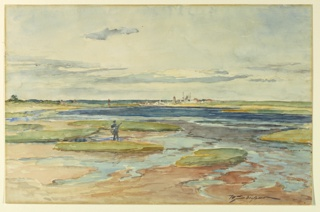 Figure in foreground, standing on a grassy patch surrounded by water and sand. Buildings, beyond, center.