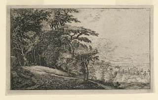Landscape scene with tree-topped hill at left, valley with small town at right.