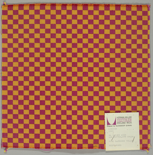 Small checkerboard pattern woven in dark pink and orange. Cut on all 4 sides.