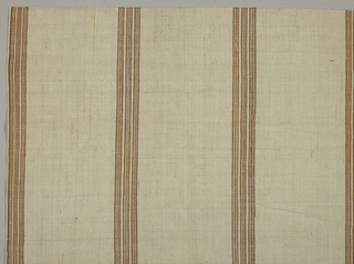 Groups of three pencil stripes in brown at broad intervals on natural ground.