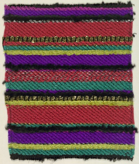 Woven sample with horizontal stripes in varied widths in purple, blue-green, red, black and yellow-green with gold and silver metallic effects. Warps are black mercerized cotton; wefts are synthetic yarns in red and purple, yellow-green chenille, turquoise silk floss, gold Lurex strips, silver Lurex strips, and wrapped metallic yarns.