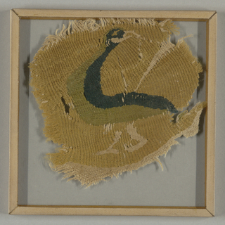 Roundel with a golden yellow ground filled by walking bird with back-turned head; in blue-green, yellow-green wools and undyed linen on linen warps. Remains of cloth ground at bottom. Warps paired in tapestry weave.