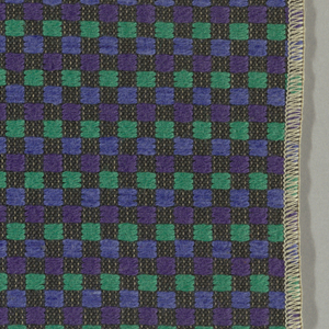 Black warp and weft with purple, blue and green supplementary wefts that form checks.  Serged on 2 sides and cut on 2 sides.