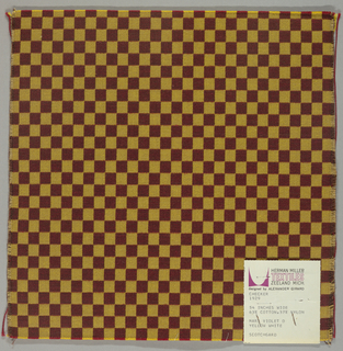 Small checkerboard pattern woven in orange and tan/green. Cut on all 4 sides.