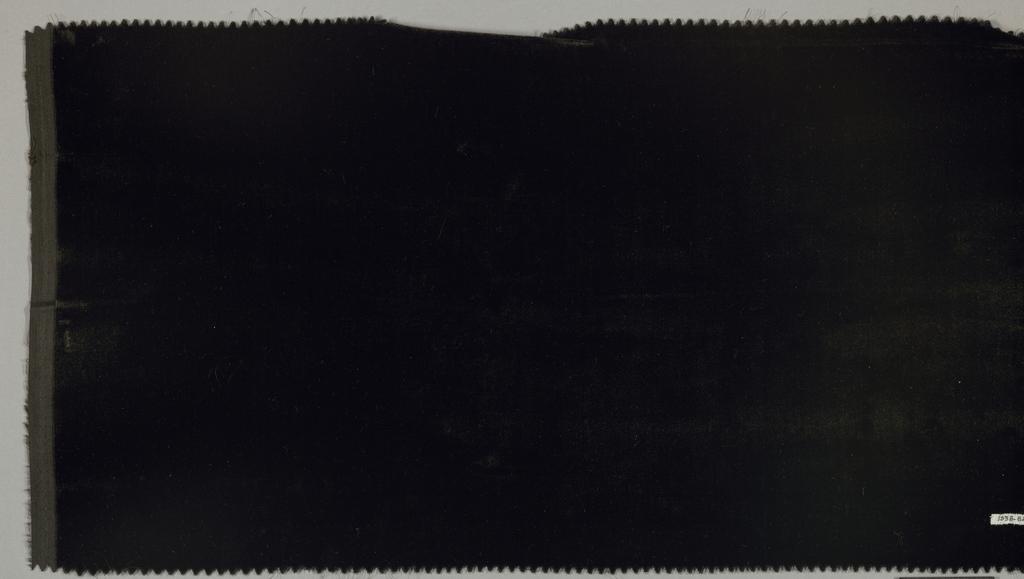 """Sample of solid black cut """"transparent"""" velvet."""