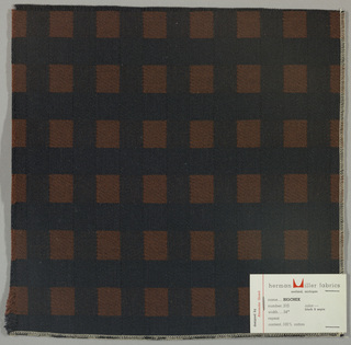 Black warp with brown and black wefts, alternating color every inch to form a checked pattern. Serged on 2 sides and cut on 2 sides.