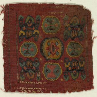 Woven square with a red ground containing strictly frontal human seated figure with hands raised in each corner; hourglass motif in a blue-green frame between each pair, and in center, a symmetrical motif of a lozenge with four dots on an orange ground. Soumak was used to outline the frames with hourglass motifs. Small area of white cross stitch on bottom left side.