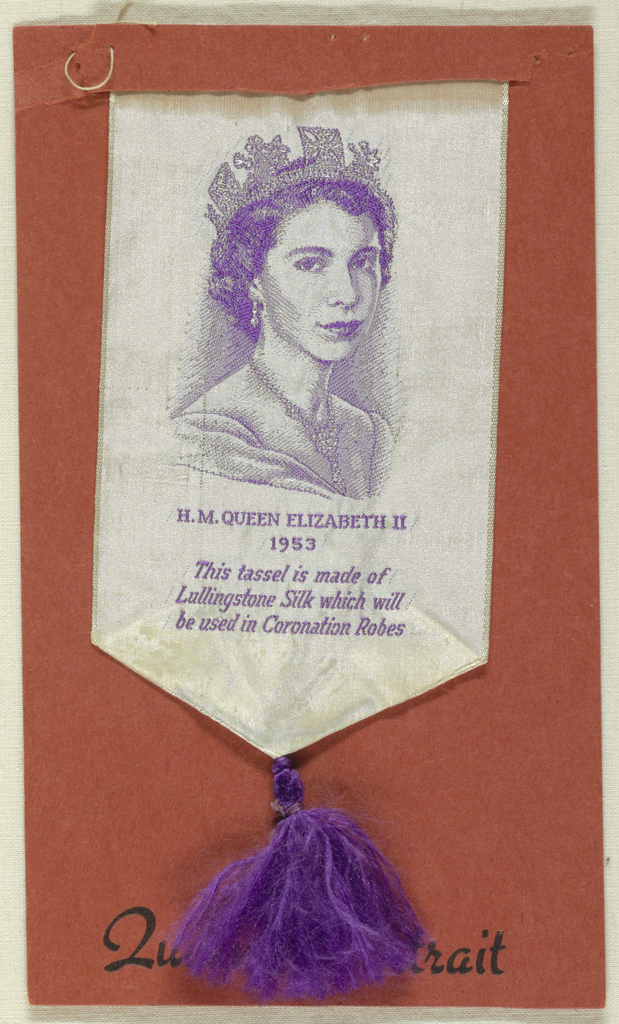 """Ribbon of fine white ribbed silk with head and shoulders of Queen Elizabeth finely brocaded in purple silk with inscription below: """"H. M. QUEEN ELIZABETH II 1953 This tassel is made of Lullingstone Silk which will be used in Coronation Robes."""" Lower end folded to form point, from which hangs a purple silk tassel.  This ribbon commemorates Elizabeth's Coronation."""