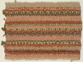 Woven sample with horizontal stripes of varied widths in soft orange, rust and brown with gold metallic effects. Warps are heavy beige silk floss; wefts are chenille yarns in orange, rust and brown, braided gold foil strips, copper-colored woven braid, and copper wrapped metallic yarns.