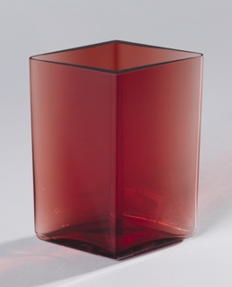 Tall diamond shaped red-toned body of transparent glass.