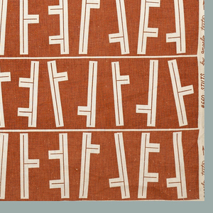 Length of printed cotton with horizontal bands of tilting vertical elements with small projections branching off of them, in reserved natural color on a printed orange ground.