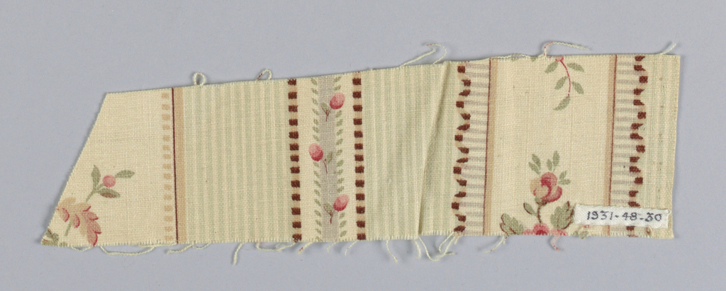 White ground printed with a design of vertical stripes, some with superimposed floral sprays and garlands, some with rosebud ribbons, and some made up of many fine stripes. Printed in rose, red, pink, yellow, brown, green, blue, and purple. Right selvage present.