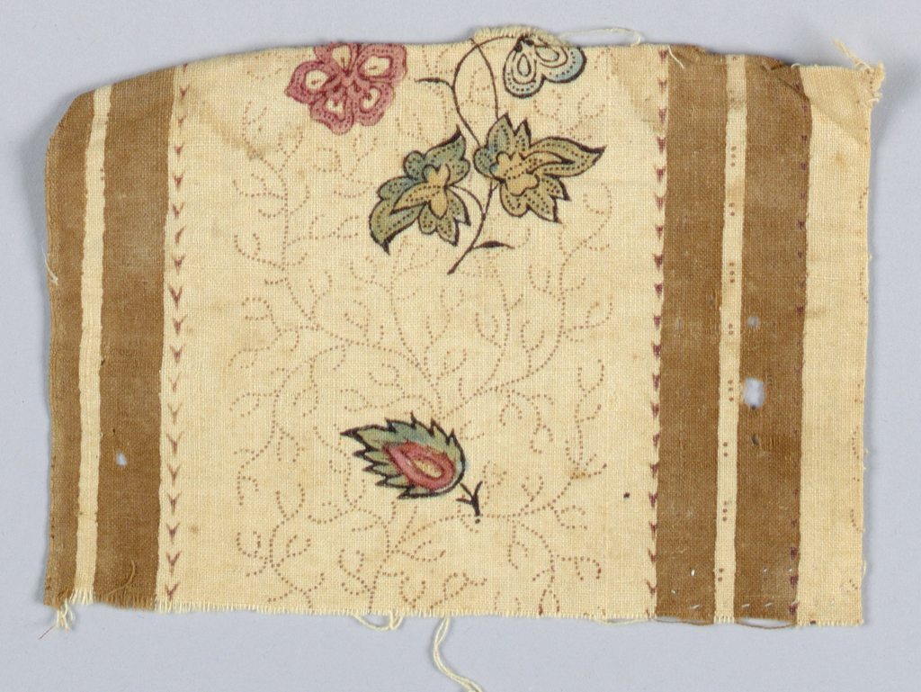 Small off-white fragment with two brown stripes on either side. The central off-white stripe is printed with a flower spray and leaf in red, blue, yellow and black. A very fine trailing vine in brown picotage forms the background pattern.