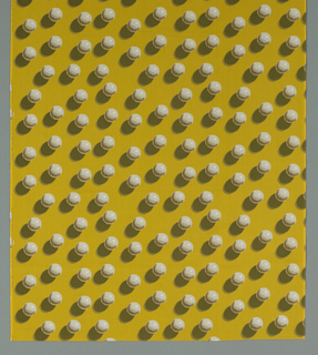 Length of printed cotton with an acid yellow ground and an all-over trompe l'oeil pattern of golf balls and their shadows.
