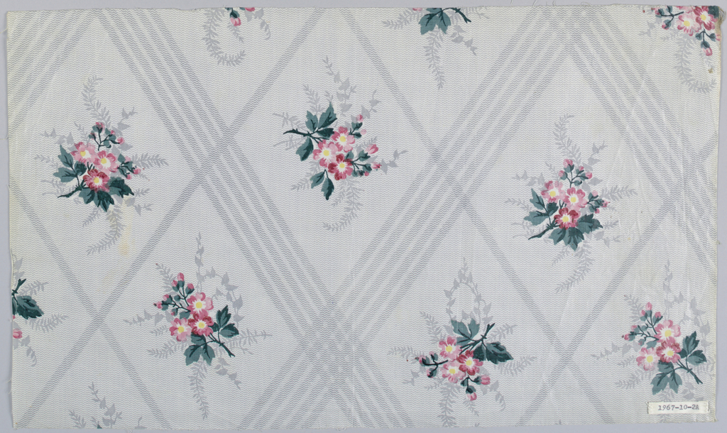 "Three pieces, same design, different colors. A) Ground printed, probably by ""molette,"" in two shades of grey in minute zig-zags; darker shade forming trellis pattern. Small flower clusters in rose with green foliage and shadowy grey foliage, printed within trellis, probably by block. B) Same design but ground slightly blue-grey. C) Same design but ground in yellow. Glazed."