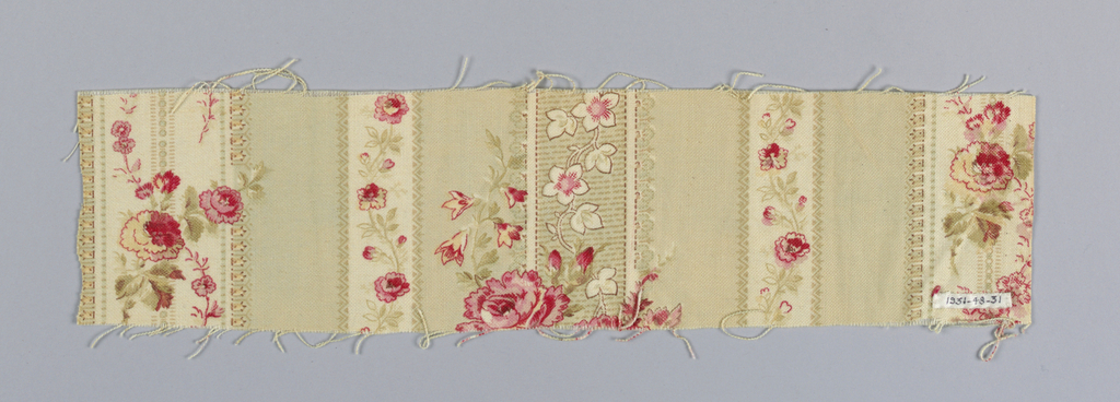 White ground printed in vertical stripes of varying widths in red, rose, pink, green, yellow, and brown. Some stripes have small-scale flowering vines and sprays.