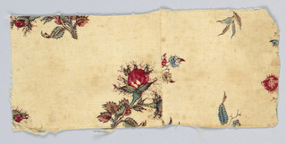 Small rectangular fragment, seamed in the middle, in a design of rosebuds on a cream-colored ground.