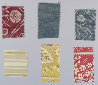 Six printed samples, mostly for draperies. Four have floral designs, three are glazed chintzes. Colors are yellow, brown, tan, red and blue. One sample is plain