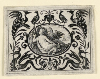 Horizontal oval within horizontal rectangle. In an animal-grotesque field the medallion depicts a seated women looks into a handmirror in a landscape.