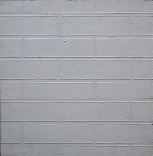 Heavy wallpaper in low relief to simulate a white brick wall.