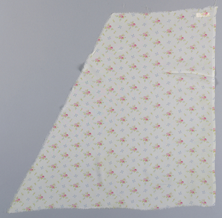 Length of printed sheer fabric patterned by very small clusters of pink roses, green leaves and a small blue bow knots on a white ground.