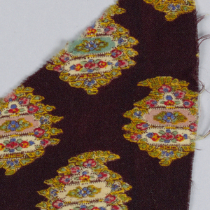 Pattern of a cone-shaped ornament with polychrome flowers sprinkled on brown ground.