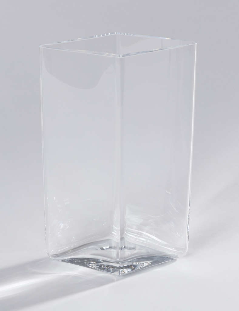 Tall diamond shaped body of transparent glass.