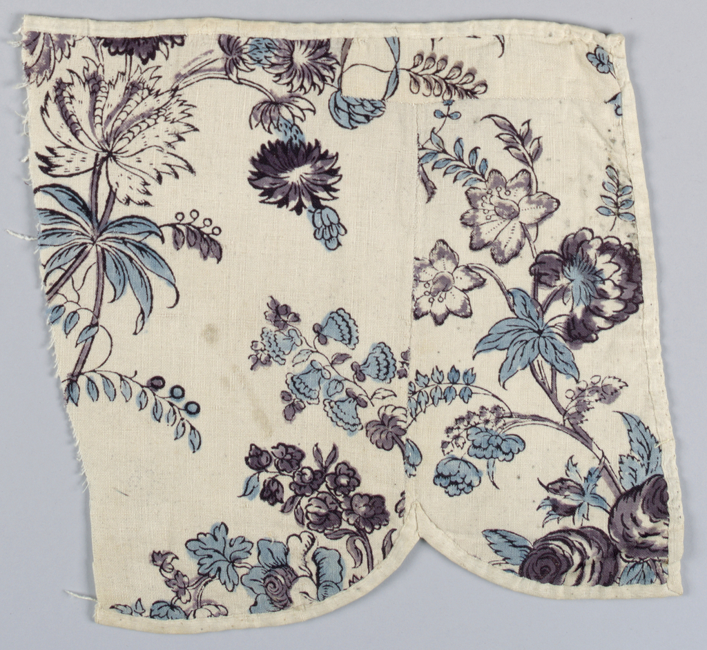Stylistic flowers in purple, light blue and black on an off-white ground