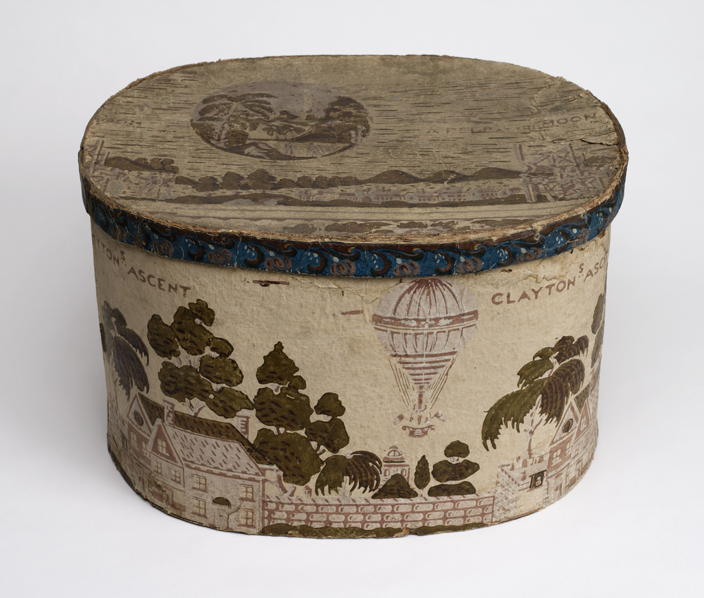 "Box shows houses and trees, with a hot air balloon; legend: ""Clayton's Ascent."" Lid features legend: ""A Peep at the Moon."" A telescope, attached to a skeleton framework, is focused on the moon.  Life on the moon is plainly visible. Three aeronautical figures with wings are engaged in temporal pursuits. A lamb appears in the foreground with palm trees and volcano in the background. Printed in pink, white and green on a cream field."