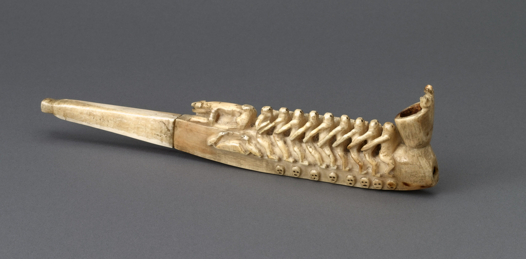 Long carved horizontal ivory body tapering to stem with circular mouth piece at one end, smoke hole with conical bowl at other end. Bowl carved with torso of figure with upraised arms.  Central part of body carved as row of 9 seated figures with crouching dog(?).  On one side, each figure's arm linked to the shoulder of the figure preceding, terminating with a figure at the front (towards bowl) with arm at his side.  Below figures, figures's feet rest on horizontal deck(?) surmounting a row of 7 carved masks.  To the right, 3 ducks or geese in a row.  On the other side, each figure's arm linked to the waist of the figure behind, terminating with a figure at the back (near mouth piece) whose arm is bent forward.  Below figures, 8 carved masks.  2 ducks or geese face one another over a rock(?) or mound.