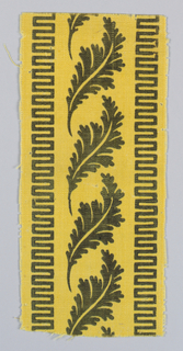 Border fragment of black acanthus leaves with bands of geometric fretwork on a yellow ground.