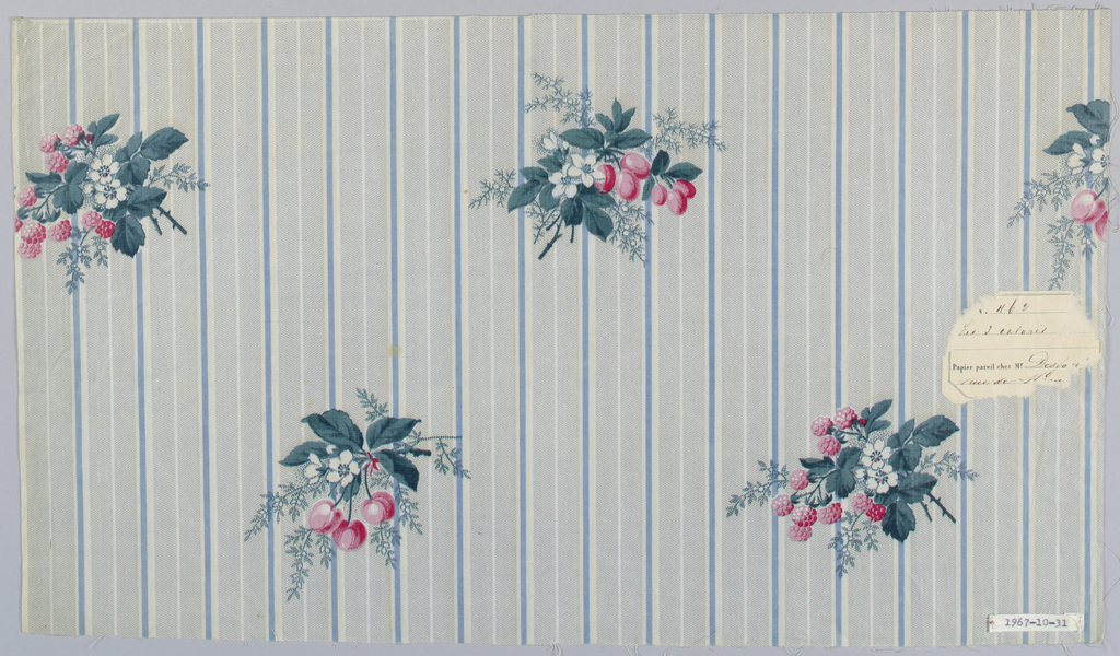Ground printed with narrow blue stripes interspersed with Herringbone stripes in grey (molette printed). Overprinted are sprays of raspberries, cherries, blossoms and leaves in pink, green and white.