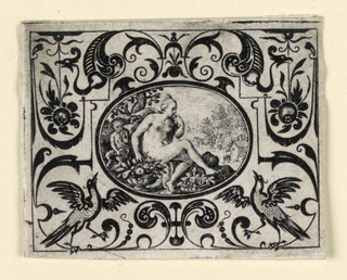 Horizontal oval within horizontal rectangle. In an animal-grotesque field the medallion depcits a seated women eats a fruit in a garden.