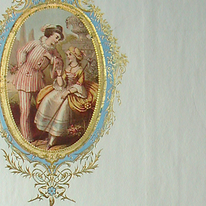 Two vertical oval medallions, at upper left and lower right, enclosed by framework in neo-Louis XVI style. Printed in blue and over-stamped in gold; diagonally repeating foliate medallion enclosed applied color lithograph displaying woman in the costume of a shepherdess, and of a man in red and white striped clothing, against a garden in the background; lower right medallion encloses another lithograph representing the figure of a woman in costume of about 1770, and a man with a lute. Vertical rectangle.