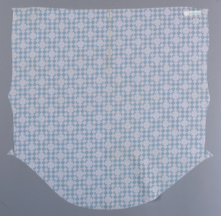 Length of printed cotton patterned by rows of diamond shapes in two alternating colors. Larger squares in a staggered repeat appear over diamond shapes. Colorway is blue and white.