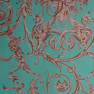 """Against a light blue ground, finely embossed, is printed an arabesque design with circular motifs composed of addorsed griffins, an urn, a chalice, bunches of roses and wheat, connected by thin, serpentine ribbons and leafy branches. Printed in several values of warm gray, with gold details. Drop match straight repeat. Printed in margin: """"590""""."""