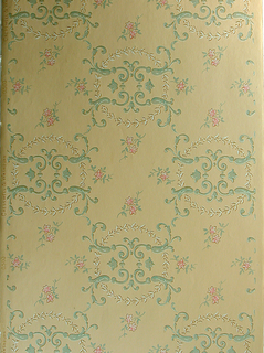 Ceiling paper, motifs of four foliate scrolls set within a laurel circle. Printed in green and pink on ochre ground.