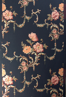 Asymmetrical styling with a Rococo revival-style influence. Two bouquets of pink and yellow flowers alternate diagonally.  Vines and scrollwork embellish and connect these motifs. Straight across match. Printed in colors on dark blue ground.