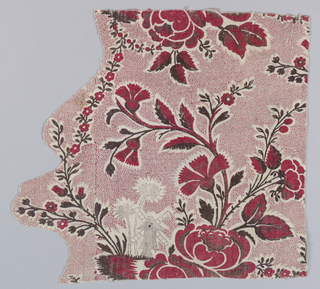 Handblocked textile in an incomplete floral pattern in madder colors of red and brown of floral sprays. Elaborate picotage background in red, and in sepia, a picotage design of windmill and flowers.
